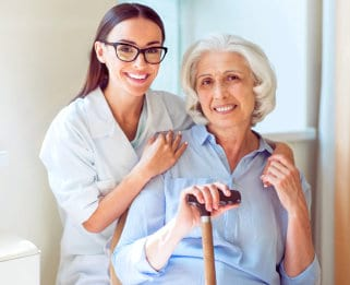 Caregiver and an elder woman both have a beautiful smile
