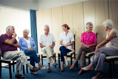 Group of elderly having a group conversation