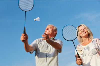 Elder couple playing badminton